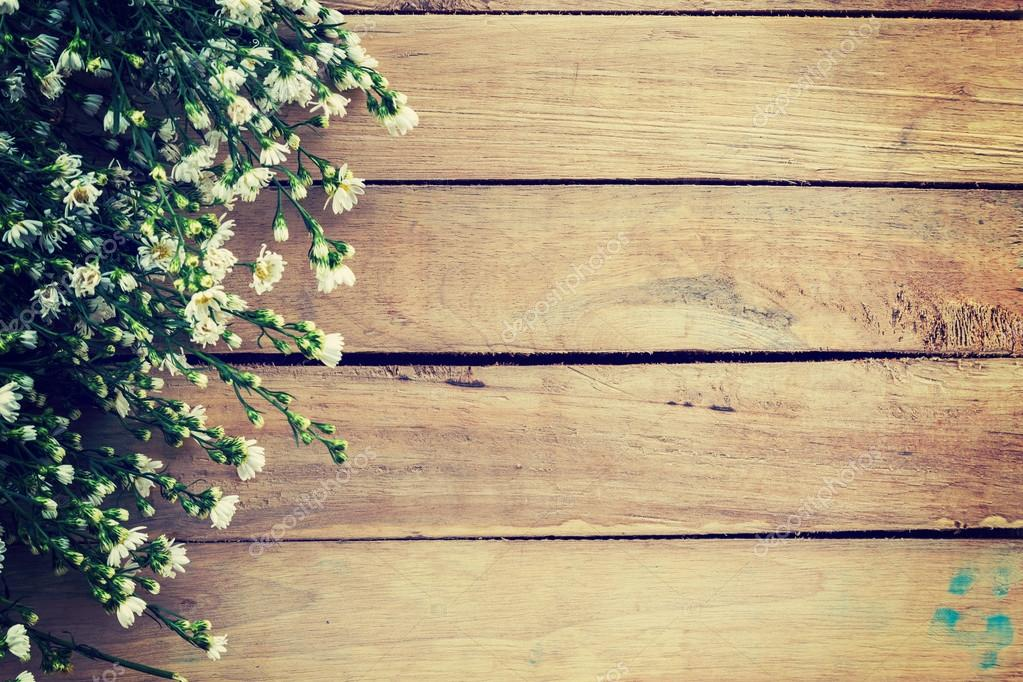 Flowers On Wood Texture Background With Copyspace. Vintage