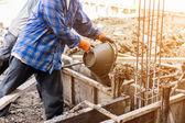 Fotografie Arbeitnehmer-Misch-Zement-Mörtel Putz für Bau mit Korina