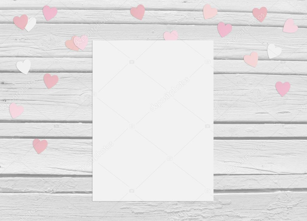 Valentines day or wedding mockup scene with blank card, paper hearts confetti and wooden background
