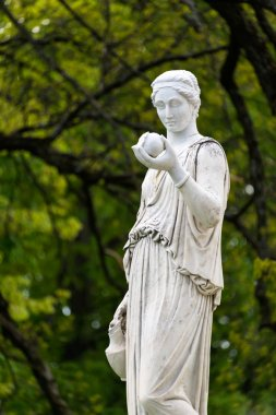 Marble statue of the Greek goddess Hera or the Roman goddess Juno, holding an apple of discord in the park of the Palace and park complex Estate of G. Galagan. Sokyryntsi village, Ukraine.