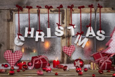 Country style christmas decoration in red, white and wood on an