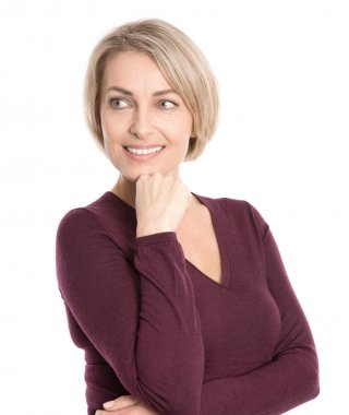 Isolated smiling middle aged woman in fall clothes looking sidew