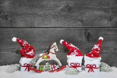 Classical christmas decoration in red, white and green on wooden