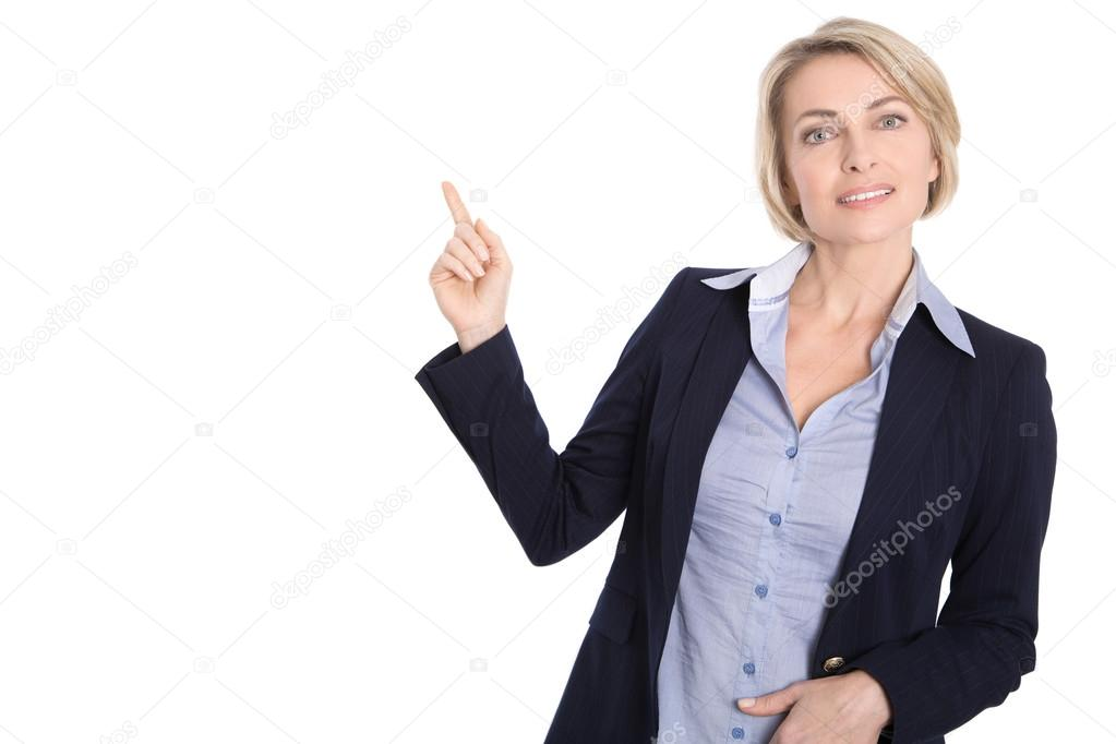 Isolated middle aged business woman pointing at white with finge