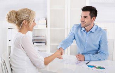 Handshake: Adviser says hello to his female customer.