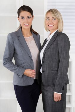 Team Portrait: Successful business woman making career in manage