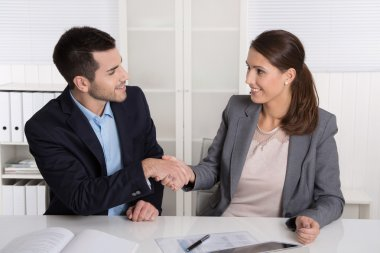 Business talk with shaking hands: counselor and customer or hell