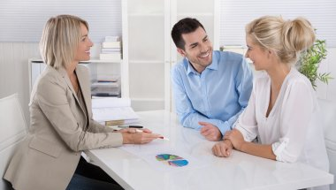 Young couple in a date with a banker or adviser for retirement a