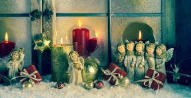 Atmospheric classic christmas decoration with angels, presents a