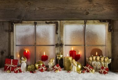Classical christmas wooden window decoration with red candles an