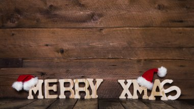 Merry Xmas letters on wooden background: idea for a greeting car