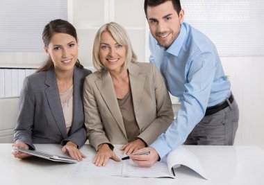 Business Team: Man and woman group in a meeting talking about fa