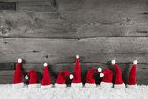 Dřevěný Vánoční pozadí s červeným santa čepice pro slavnostní fr
