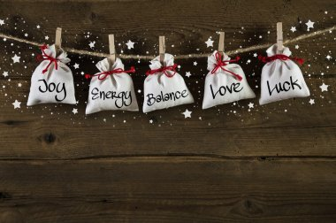 Wooden christmas background: greeting card with presents and tex