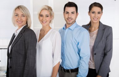 Portrait: female boss with her staff. Sucessful team.