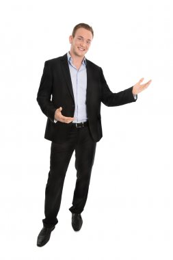 Handsome happy isolated young businessman presenting with hands.