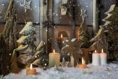 Handmade christmas decoration with wooden trees and reindeer.