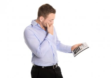 Shocked  businessman with pocket calculator about increased cost