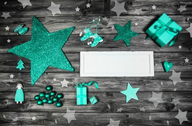 Merry christmas card in white and turquoise green colors.