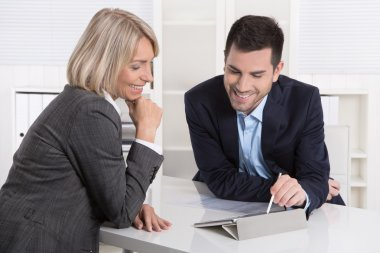 Successful business team or costumer and client in a meeting.
