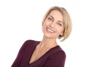 Lucky isolated blond mature woman with white teeth and pullover