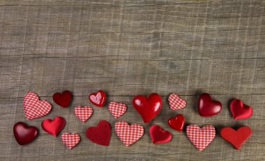 Festive wooden background with red white checked hearts for chri