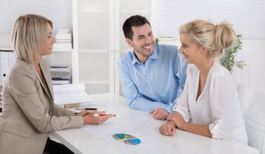 Young couple customers and adviser or agent talking about financ