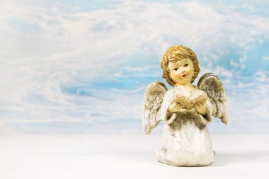 Christmas angel reading in a book telling a story for xmas.