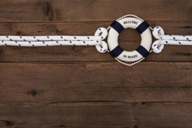 Cooperation concept: Wooden brown nautical background with a blu