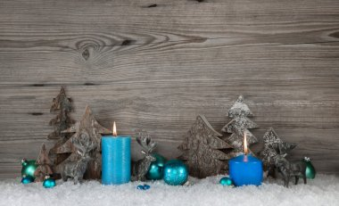 Rustic wooden christmas background with two blue or turquoise ca