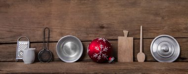 Old kitchen miniatures on wooden background for christmas decora