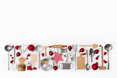 Christmas decoration of old red, white and silver cutlery and di