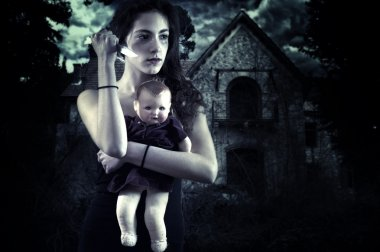 Teenage girl with knife and doll in front of a haunted house