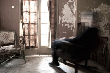 Man sitting on rocking chair