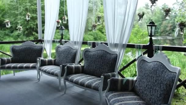 Four Sofas Stand on the Terrace Over the Water