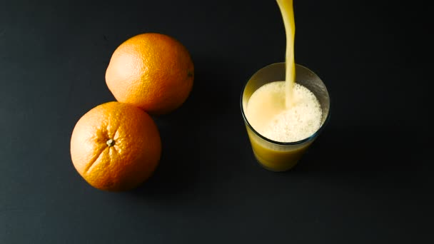 Orange Juice is Poured Into a Glass, Top View,