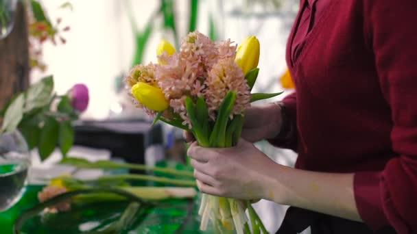 Florist Make a Bouquet of Tulips and Lilies