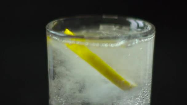 Round Slice of Lemon Drops in Water