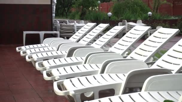 Sun Beds For Relaxing, Standing in a Row, White Plastic, Empty, Loneliness, no People, Beautiful Vacation, 4k