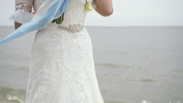 Tender Bride in Lace Dress Standing Near the Lake