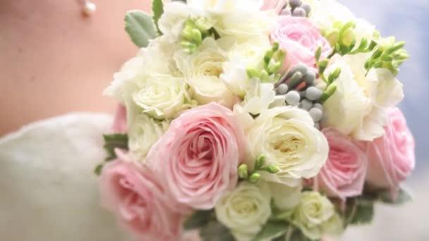 bride presses her wedding bouquet