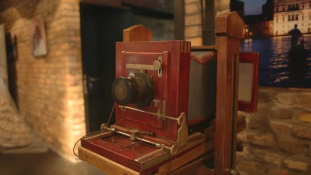 old wooden camera on a tripod