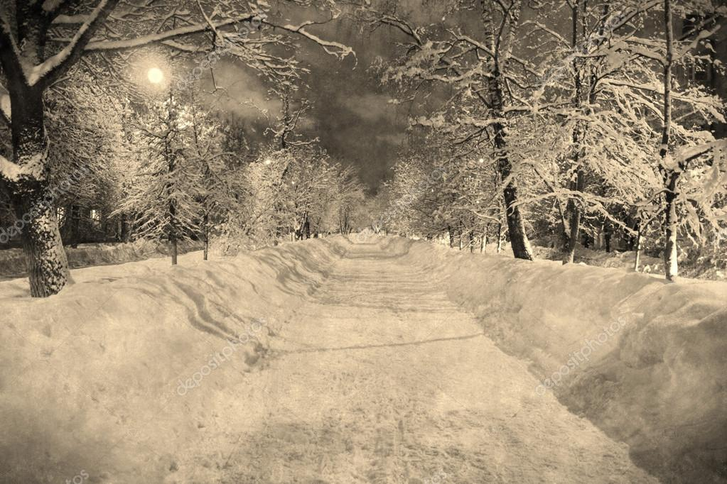 Winter night snowy street with moon in retro vitage style, aged photo
