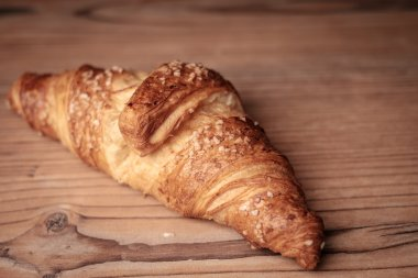 Fresh Croissant on a wooden background