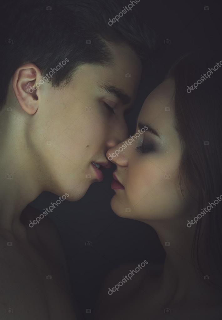 Kissing couple portrait. Instagram toned.