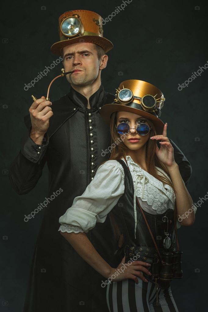 The couple steampunk. A man with a pipe and a girl with glasses ...