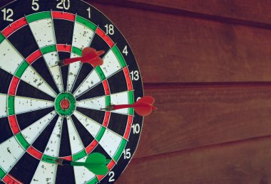 Darts over wooden background. Arrows missed target