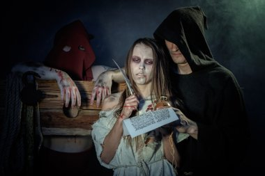 Halloween. The Middle Ages. Witch sign a verdict of the Inquisit