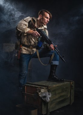 Armed man with a gun. Stalker.