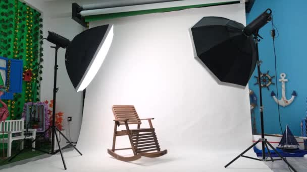 Photo or video studio with two hexagone studio lights. White screen and rocking chair